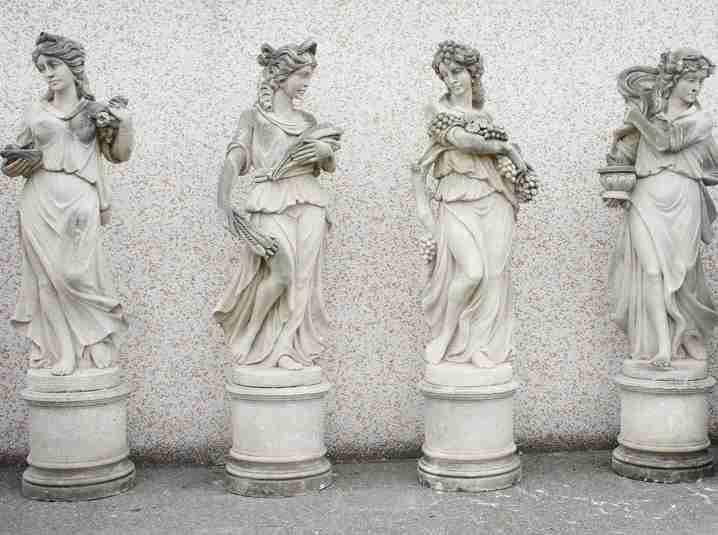 Quattro statue da giardino in pietra di Vicenza raffiguranti le Quattro Stagioni