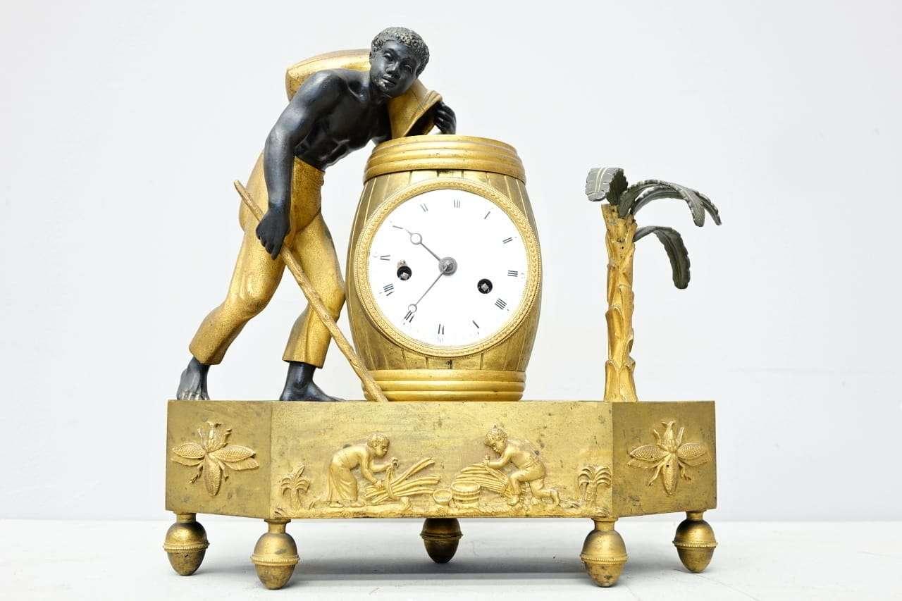 Orologio Bon Sauvage bronzo dorato e brunito