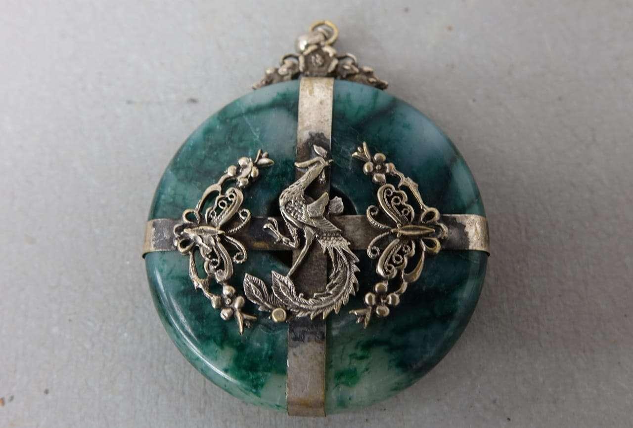 Medaglione in marmo e argento