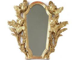 Specchiera finemente dorata oro foglia con sculture putti epoca barocca 1650 circa